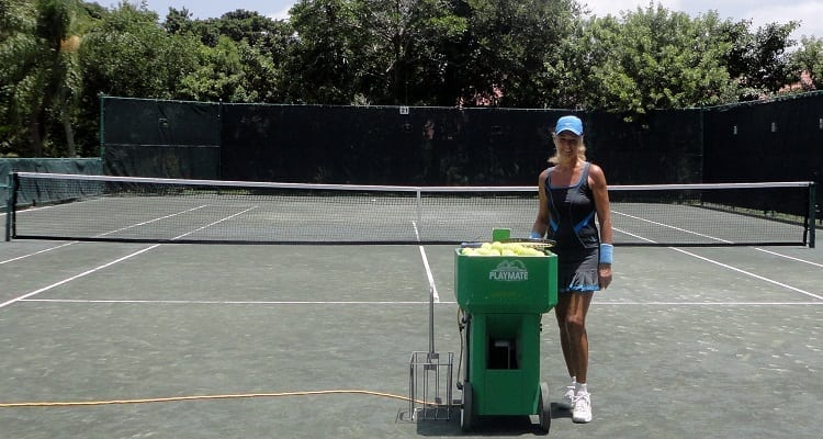 Female Tennis Player And Tennis Ball Machine