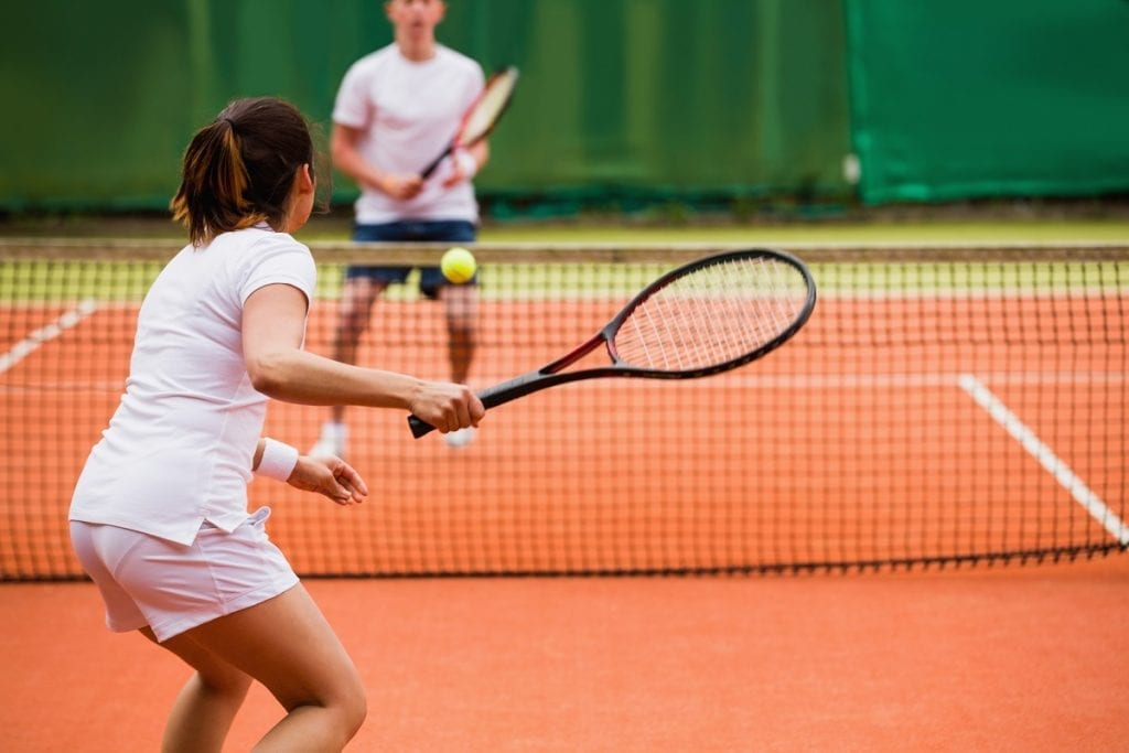 Compact tennis backswing