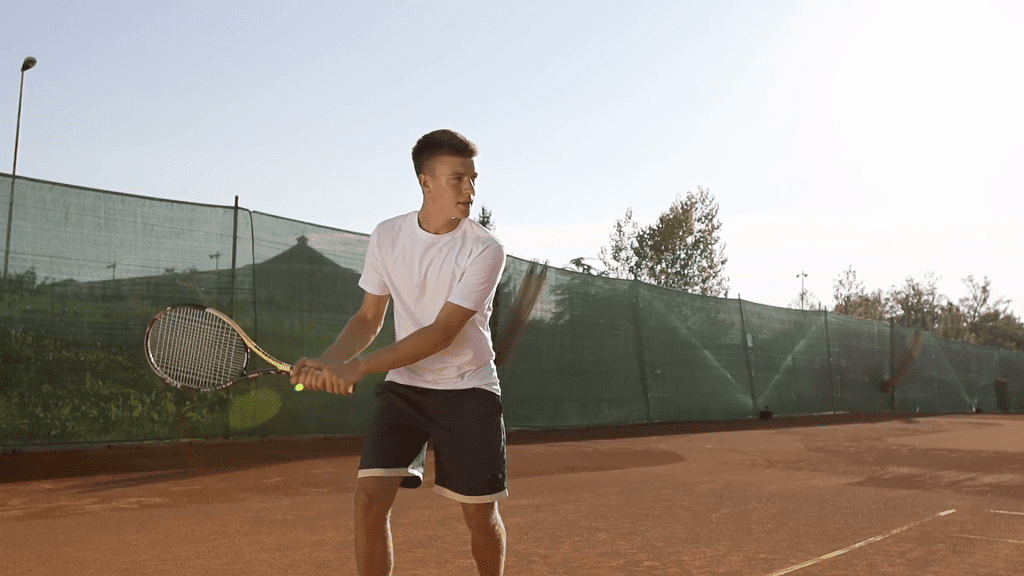 tennis shot timing - one-handed vs two-handed