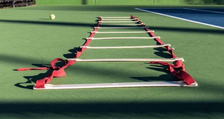 ladder on tennis court for footwork drills