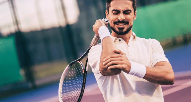 man indicating tennis elbow pain
